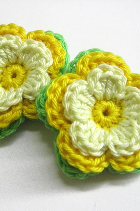 Handmade crocheted cotton flower appliques in yellow and green shades