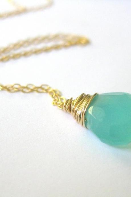 Aqua blue chalcedony and gold necklace. 14K gold filled wire wrapped semi-precious chalcedony gemstone on fine gold chain.