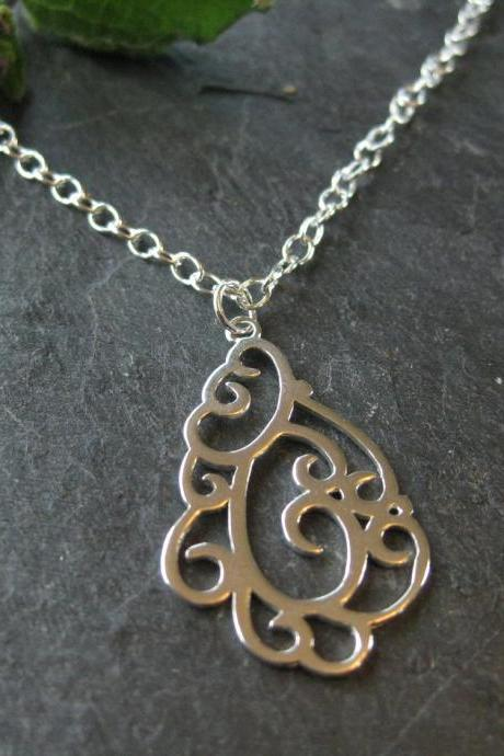 Sterling swirly pendant necklace, silver oval link chain