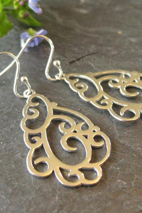 Sterling silver unique swirly design earrings
