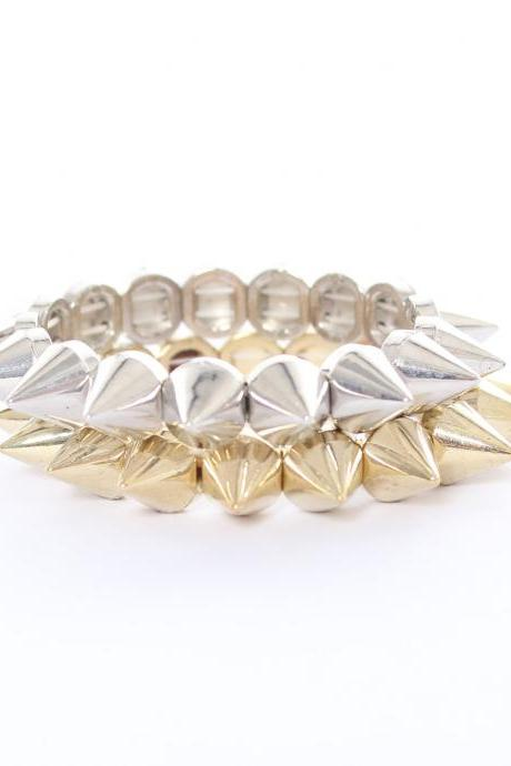 Pair of gold and silver studs and spikes bracelets