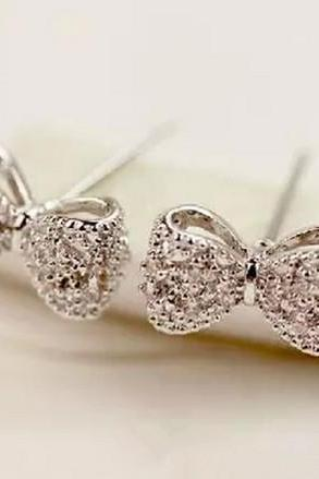 Fashion White Rhinestones Embellished Bowknot Shaped Metal Earrings