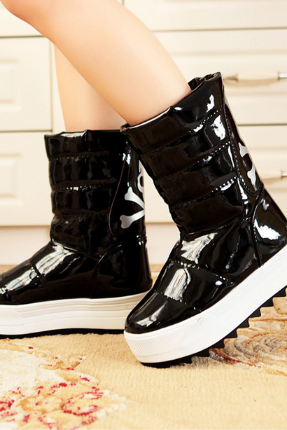 The new patent leather boots with thick leather mirror muffin bottom waterproof Taiwan women winter boots