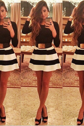 Women wear long sleeved T-shirt black and white striped skirt