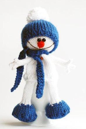 Lovely and sweet Snowman in the blue hat and scarf for keeping warm breakfast egg. Egg cozy. Funny breakfast. New Year decoration.