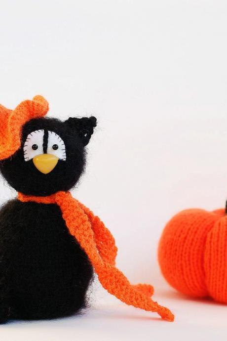 Black Cat in the orange scarf. Halloween toy. Decoration for halloween