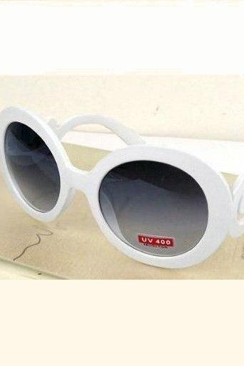 Classy woman round lens white sunglasses