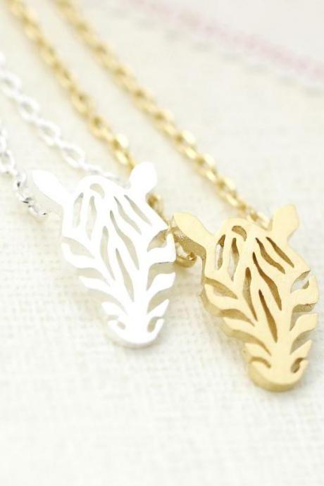 Cut-out Zebra Pendant Necklace in gold / silver