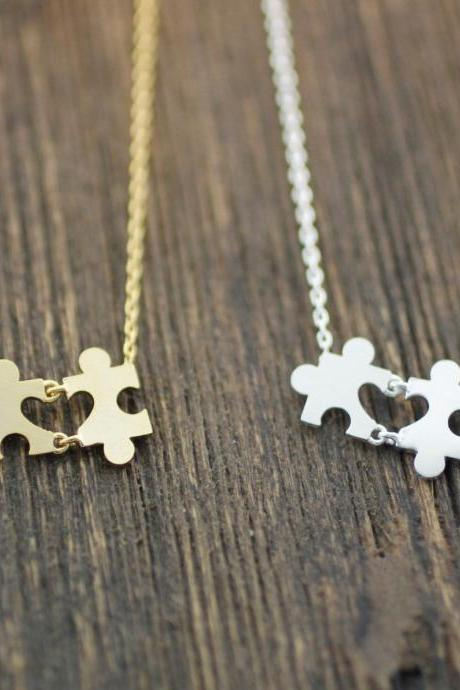The Heart in the Puzzle Necklace in silver / gold