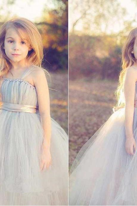 Custom made tulle flower girl dress features sleeveless tank bodice with gathered details neckline and spaghetti straps. Sheer satin ribbon at waist with cute bow on back adds extra princess touch for this original beautiful tulle ensemble.
