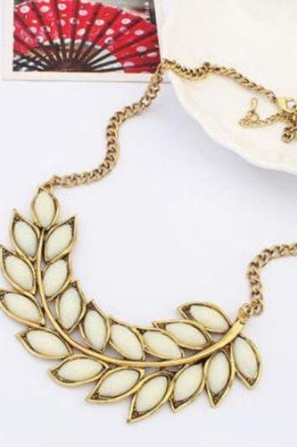 Statement leaves casual outfit white woman necklace