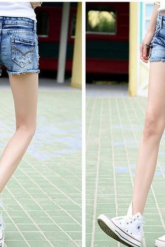 The new fashion wear white worn light-colored denim shorts