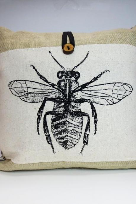 Burlap throw pillow with bee screen print design