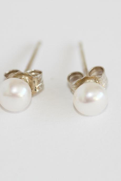 Ivory freshwater pearl and sterling silver stud earrings.
