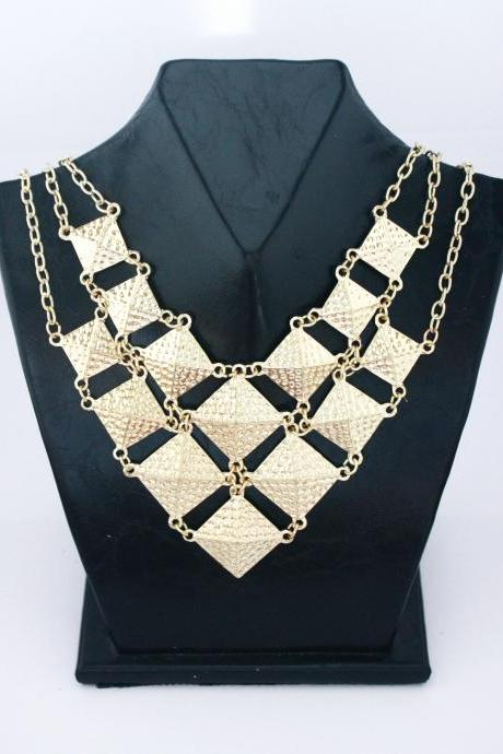 Statement gold colored woman party dress necklace