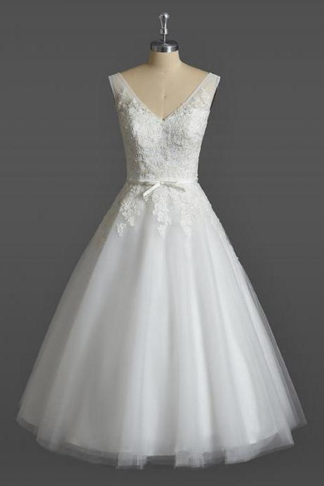Ivory Short Tulle Wedding Gown Featuring Lace Appliqué Sleeveless Plunge V Bodice and Bow Accent Belt