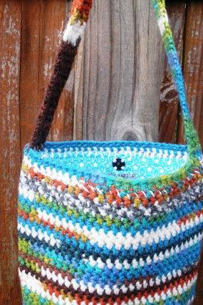 Multicolor crochet shoulder purse with turquoise flannel star print lining, ready to ship.
