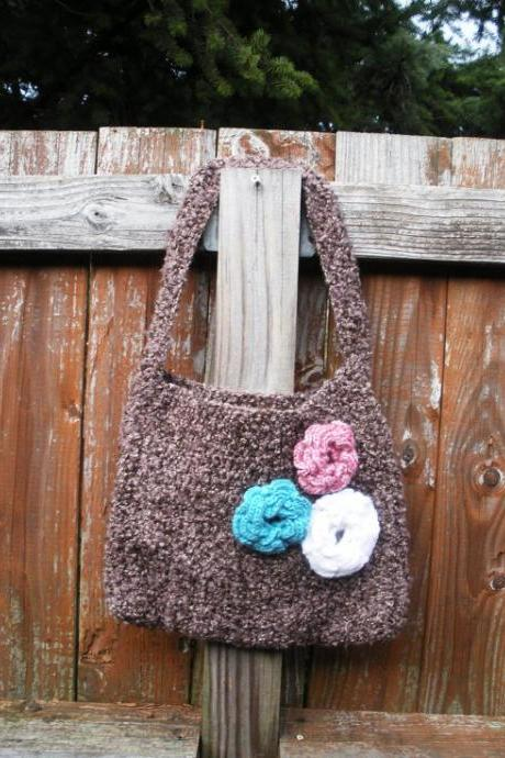 Brown boucle crochet shoulder purse with floral rose detail at front and flannel butterfly lining.
