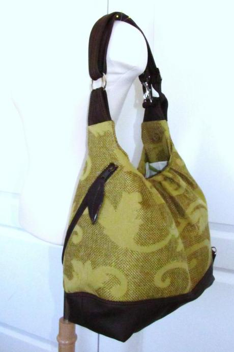 Green/gold vines canvas convertible bag w/ leather straps and base